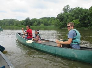 Neill canoeing with campers!